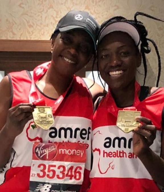 Bracknell News: The pair each received a medal from the London Marathon